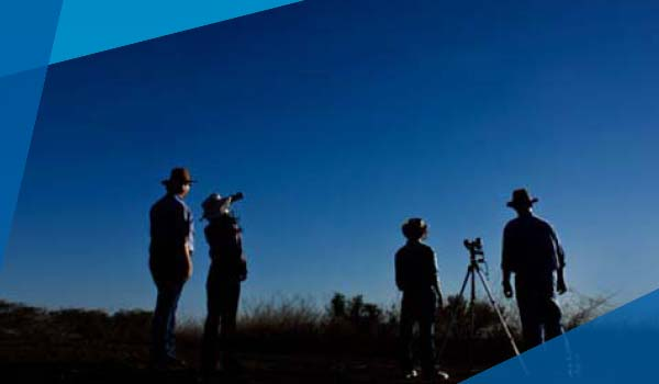 People looking at stars in the outback