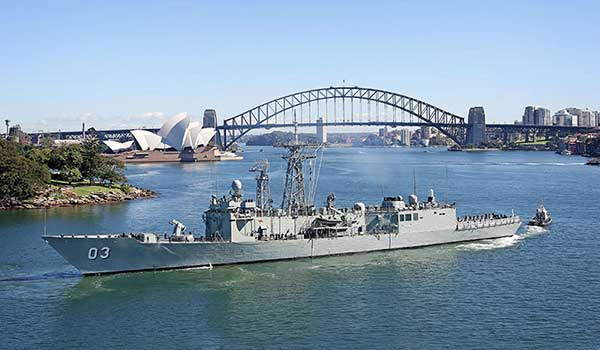 Navy ship in front of Sydney Harbour Bridge and Opera House