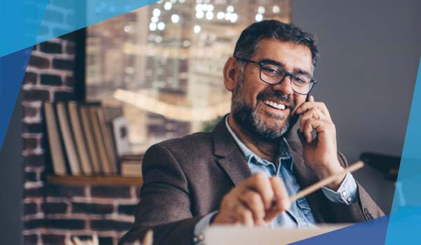 Man with glasses talking on phone