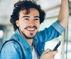 Man on bus with phone in hand