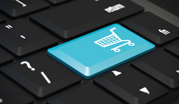 A keyboard with a shopping trolley image on a key, to show 'procurement'