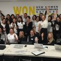 A crowd of women cheering at the opening of the Women's Online Network