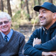 A non-Aboriginal man and Aboriginal man laughing