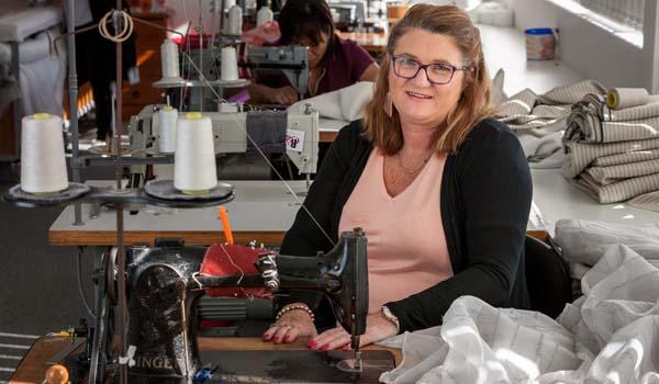 Debra Stokes at a sewing machine