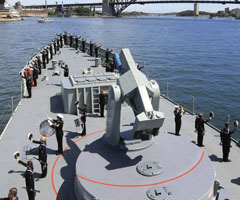 Naval officers saluting on ship