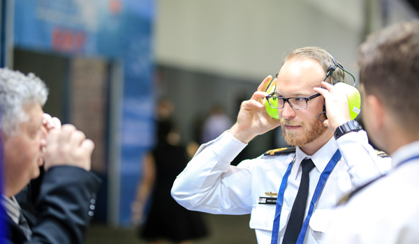 Military officer trying on headset