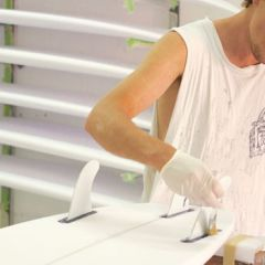 Employee painting a surfboard, The Glass Lab, Tweed Heads