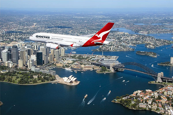 Qantas plane flying over Sydney Harbour