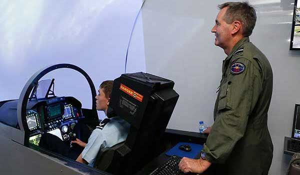 Student using simulator with teacher