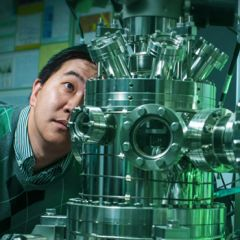 Scientist inspecting technology device