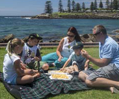Family eating lunch at Pheasant Point, Kiama