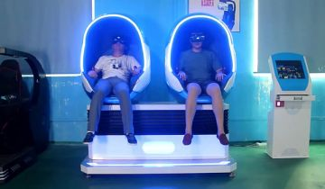 Two men in HP's Virtual Reality Pod