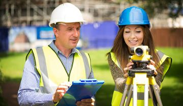 A male and female surveyor