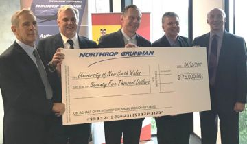 NSW Defence Advocate John Harvey, Professor Mark Hoffman, UNSW, Johnathon Green, Northrop Grumman, scholarship winner Associate Professor Robert Maloney, UNSW, and Eric Rienke, Northrop Grumman with large cheque