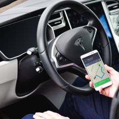 Driver with Taxify app in hand