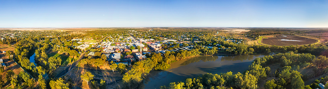 Moree town centre on Gwydir river shores in Narrabri shire - the centre of artesian basin in rural plains of NSW, Australia. Elevated aerial wide panorama over endless flat plains.