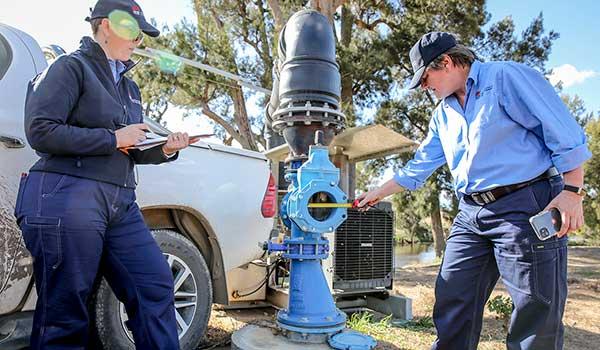 NRAR officers checking a metering pump