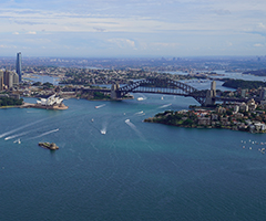 An iconic view of Sydney Harbour Bridge and the Opera house.