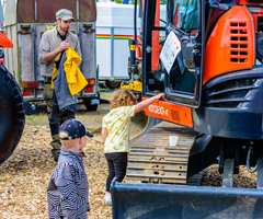 Children at showground with tractors