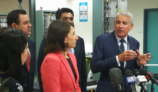Thales Australia chief executive Chris Jenkins speaks with Premier Gladys Berejiklian and Minister for Western Sydney Stuart Ayres
