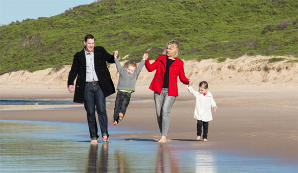 Richard Batty and family at a beach in Wyong