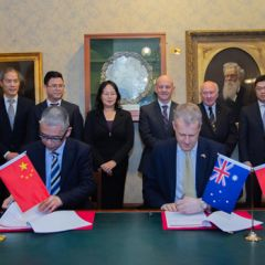 Signing ceremony between organisers of the China International Import Expo and NSW businesses.
