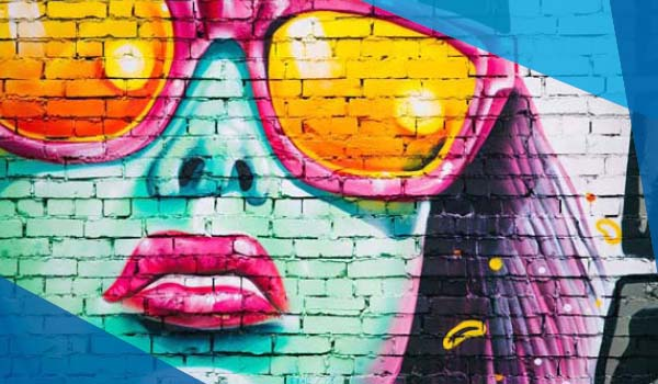 Painitng mural of a woman with sunglasses