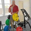 Peter Annis-Brown in gym with weights