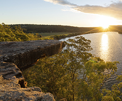 Sun setting over Hang Rock Lookout and the Shoalhaven River, in Nowra.